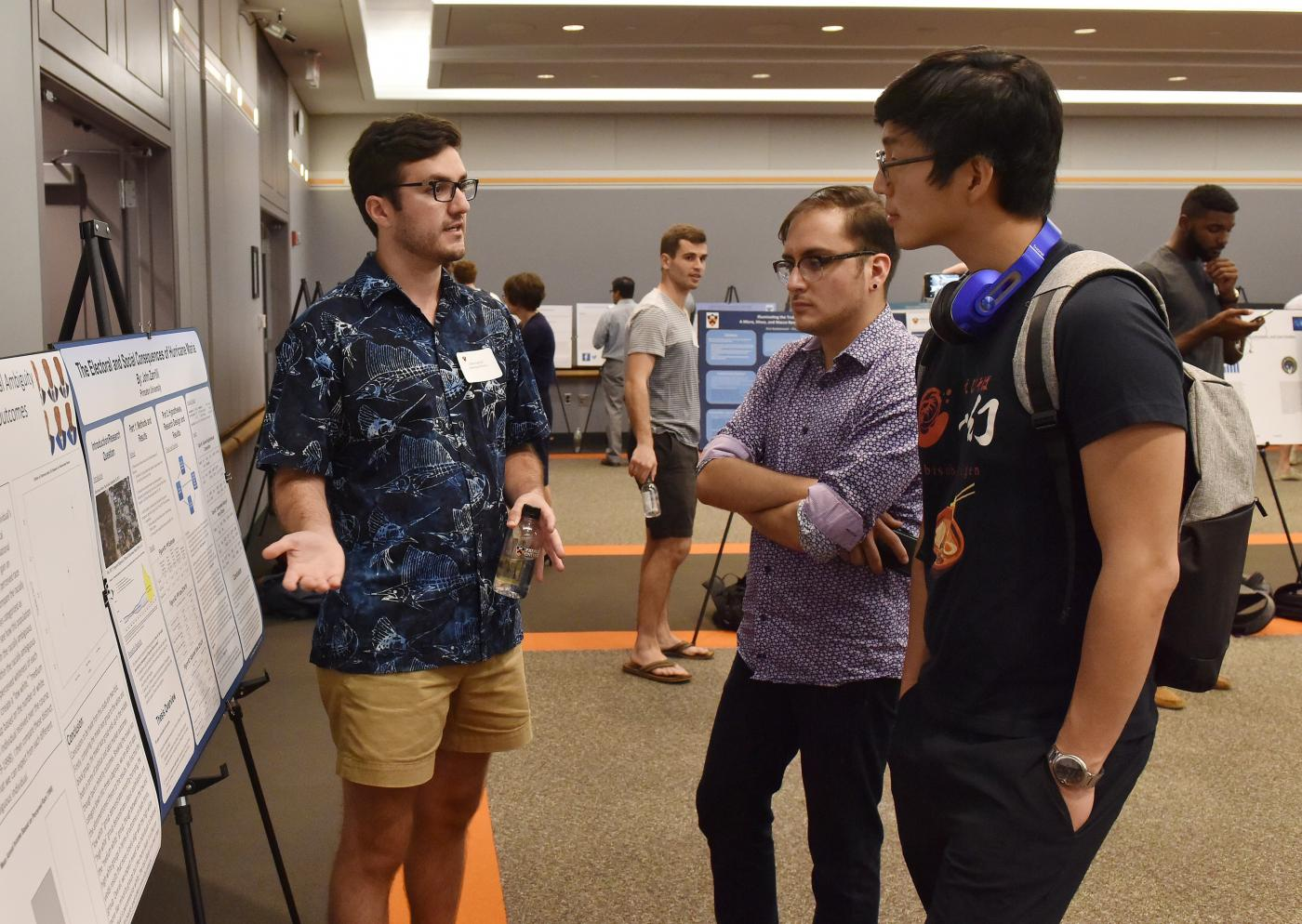Photo of three students at senior thesis research poster session