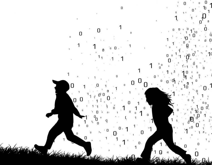 Silhouette of two children running through a cloud of ones and zeros.