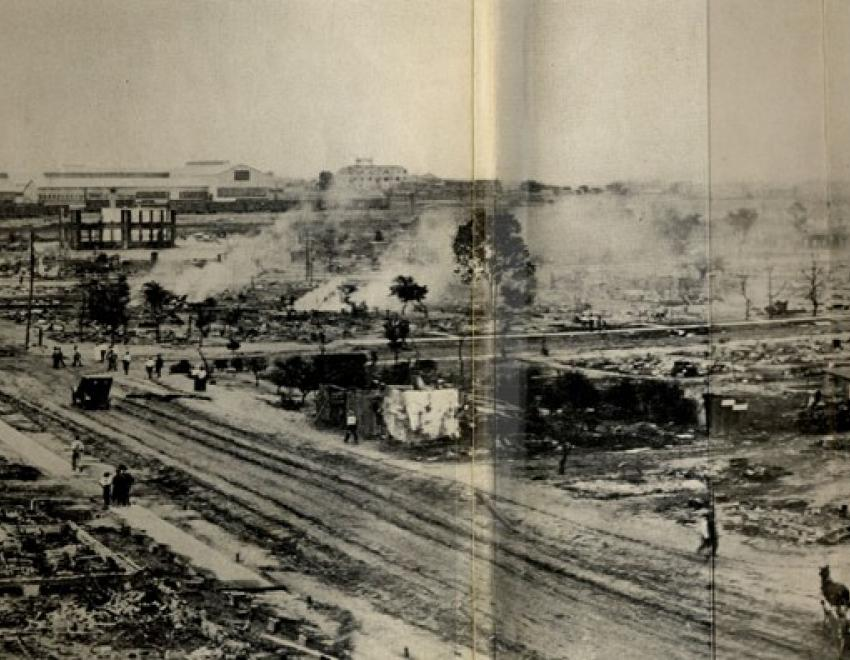 Taken from the southeast corner of the roof of Booker T. Washington High School, this panorama shows much of the damage within a day or so of the riot and the burning.  The road running laterally through the center of the image is Greenwood Avenue, the road slanting from the center to the left is Easton, and the road slanting off to the right is Frankfort.